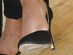 Candid soles and high-heeled shoes at work #20