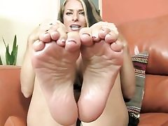 Sugary-sweet looking babe is uncovering her feet and is ready to give footjob