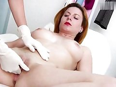 Nasty crimson haired babe gets her cunt hole examined on a gyno chair