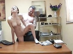 Skinny whore gets slammed on the office table and inhales trouser snake